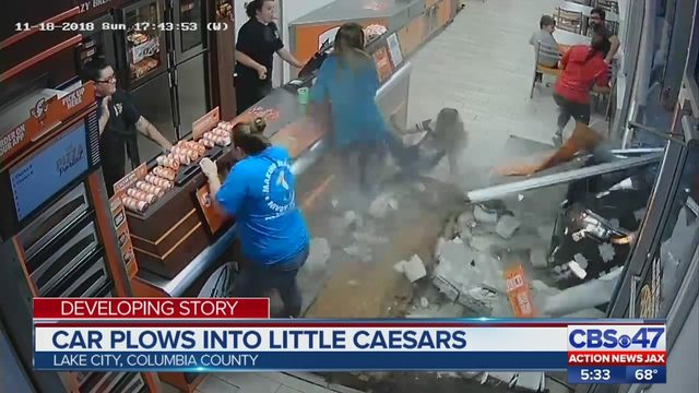 watch  driver crashes into lake city little caesars