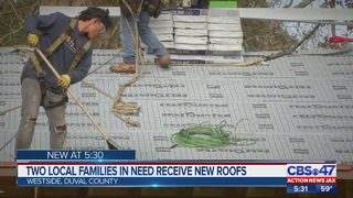 Local families in need receive new roofs