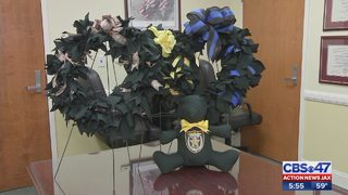 Old Clay County deputy uniforms upcycled into wreaths, teddy bears