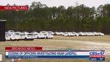 Dozens of officers investigating near landfill