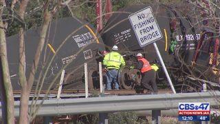 Eight-car train derailment into northside creek was carrying ethanol