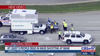 At least 5 people dead in mass shooting in bank