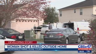 Woman shot and killed outside of home