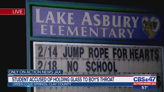 Clay County student accused of holding glass to boy