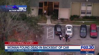 Woman found dead in backseat of car
