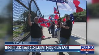 Southern heritage group waves confederate flags