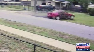 Exclusive video: Car spins out, crashes into fence outside of Jacksonville home