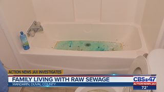 Family living with raw sewage