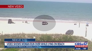 Woman run over while lying on beach