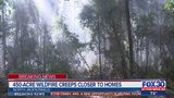 450-acre wildfire creeps closer to homes