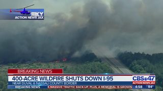 Fire burning up to the side of I-95