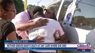 Vigil held at day care where baby died after being left in hot van