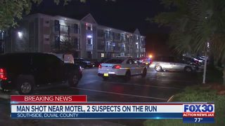 Man shot near motel, 2 suspects on the run