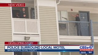 Police surround local motel on the Southside