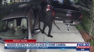 Masked man appears to point gun at camera while breaking into cars in North Jacksonville