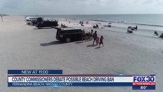 County commissioners debate possible beach driving ban