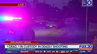 One dead, one in custody after shooting