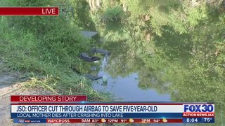 Car overturns into pond with child, mother inside