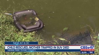 Child rescued, mother trapped in SUV died