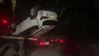 VIDEO: Vehicle overturned in lake at Hanna Park was towed away
