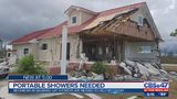 Neighbors in Bahamas say showers are needed to help recovery