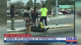 Mother hit by debris from crash at busy intersection