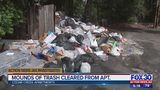 Mounds of trash cleared from apartment